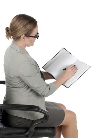 Closed up shot of sitting secretary reading her notes over a white background Stock Photo - 17353063