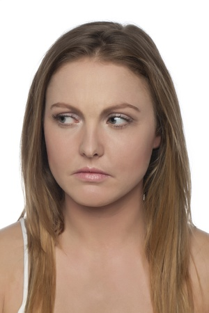 Portrait of serious woman looking at something against white background Stock Photo - 17353119