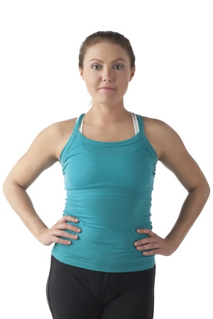 Sporty looking woman posing with hands on hips over a white background Stock Photo - 17352210