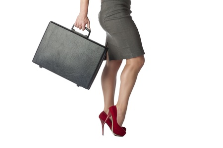 Cropped shot of standing businesswoman in red high-heeled shoes while carrying a briefcase Stock Photo - 17351670