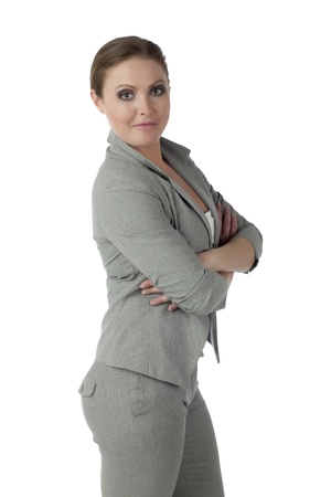 Portrait of a well dressed businesswoman with crossed arm and standing over white background Stock Photo - 17352924