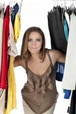 closet: Closed up shot of a mid adult woman in a closet Stock Photo