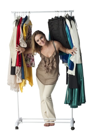 Smiling woman looking for clothes to wear in a clothes rack Stock Photo - 17352211