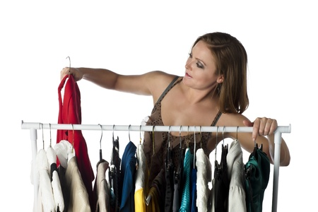 Attractive woman shopper choosing clothes in a clothes rack Stock Photo - 17352165