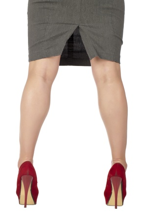 Portrait of woman wearing red high heels against white background Stock Photo - 17352426