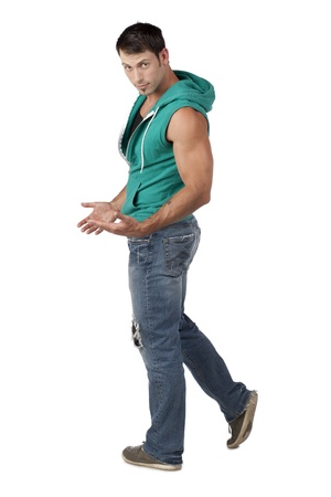 sleeveless hoodie: Portrait of muscular man wearing sleeveless hoodie standing over the white background