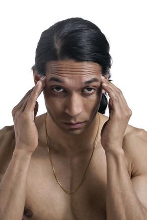 vexation: Facade shot of a man suffering headache