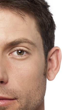 half face: Close up image of mans half face against white background Stock Photo