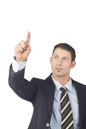Businessman pointing up in a close-up image Stock Photo - 17367737