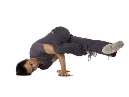 Image of a teenage Asian break dancer performing a hand stand Stock Photo - 17368450