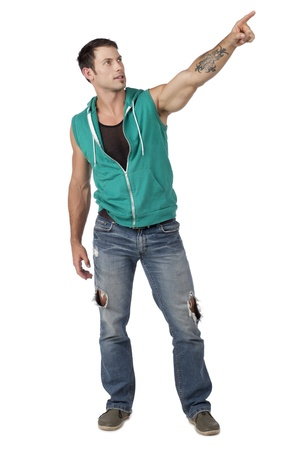 sleeveless hoodie: Attractive male dancer pointing at something over the white background Stock Photo