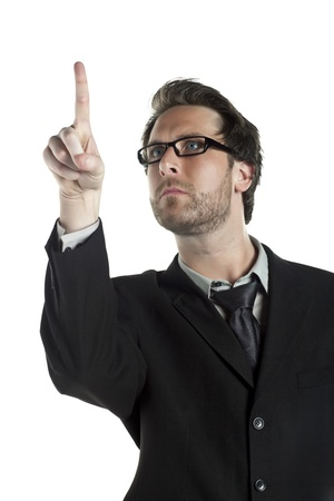 Portrait of businessman pointing something against white background Stock Photo - 17367345