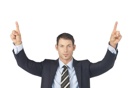 Portrait of businessman his pointing finger up against white background Stock Photo - 17367803