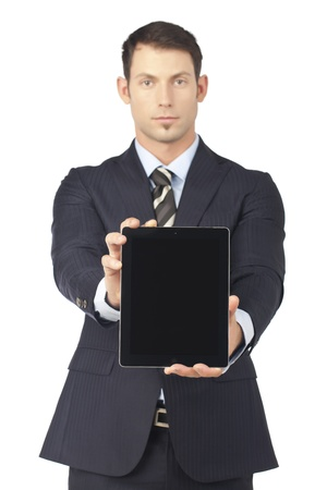 Businessman presenting a touchpad in a front view image Stock Photo - 17367538