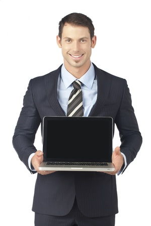 Portrait of young businessman showing a laptop over a white background photo