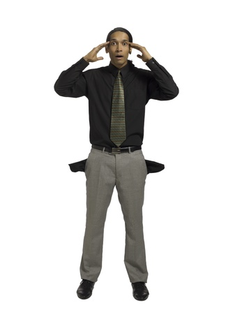Portrait of a businessman with empty pocket standing on a white surface Stock Photo - 17367776