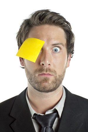 Portrait of businessman with sticky note in his one eye against white background Stock Photo - 17367288