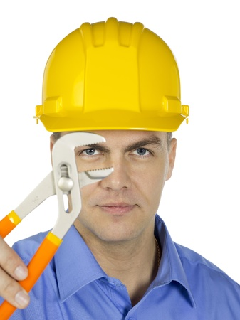 Businessman wearing a yellow hard hat with adjustable wrench photo