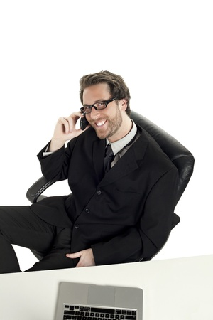High angle shot of a smiling businessman while calling at his cellphone Stock Photo - 17367419