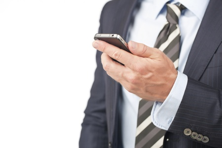 Close up image of cellphone on businessman hand against white background photo