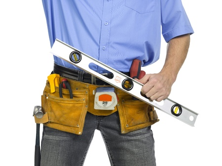Construction worker with belt and holding a level ruler