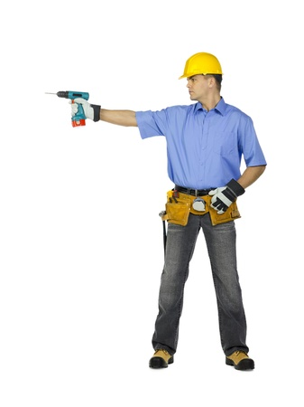 Image of a manual construction worker wearing tool belt, hard hat and holding drill machine. Model: Denis Bryzgounov Stock Photo - 17368449