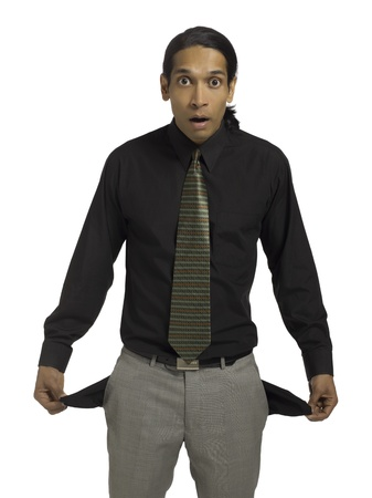 empty pockets: Financial crisis concept portrayed by a man with empty pockets