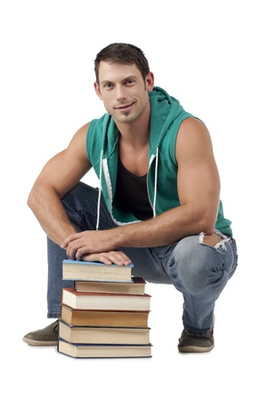 hooded vest: Portrait of smiling good looking guy with stack of books against white background