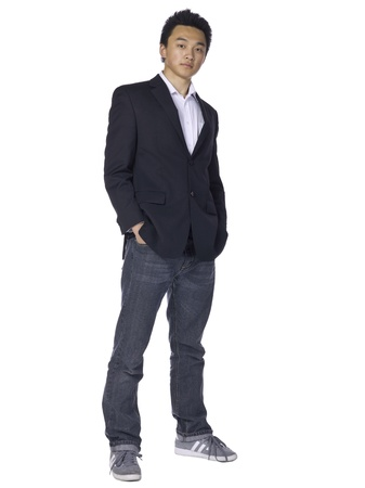 casual attire: Full length portrait of good looking teenage guy on casual attire against a white background Stock Photo
