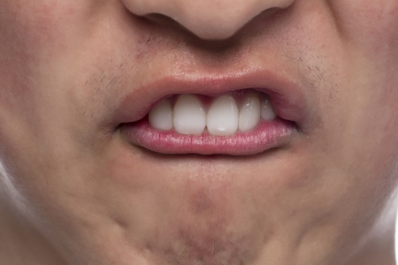 Close up image of a guy biting his lips
