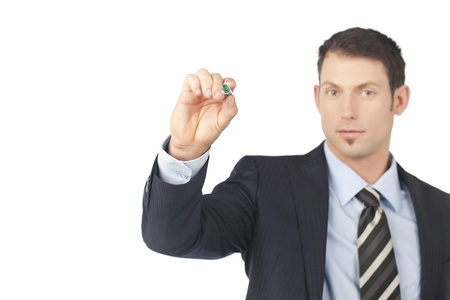 Portrait of handsome businessman pointing at something using his ball pen Stock Photo - 17367789