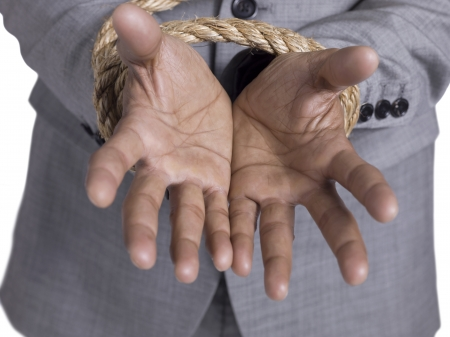 Close up image of hand tied up with rope photo