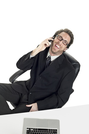 Portrait of happy businessman taking on the phone against white background Stock Photo - 17367471