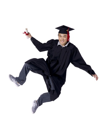 Portrait of a joyful male graduate jumping over a white background Stock Photo - 17367880