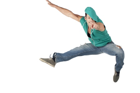 Isolated image of jumping dancer while pointing forward  over a white background photo