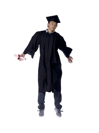 Male graduate jumping over a white background Stock Photo - 17367977