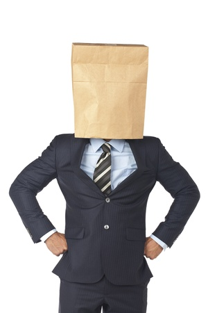 Lack of business identity concept with a businessman covering his head using a paper bag photo