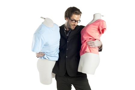 designer: Portrait of male fashion designer with mannequin against white background Stock Photo