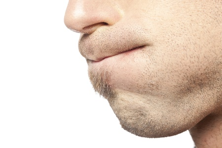 mouth close up: Close up image of mans mouth  against white background Stock Photo