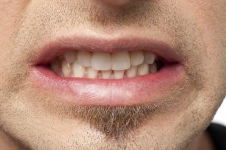 Man Grits His Teeth As He Suffers Through Pain
