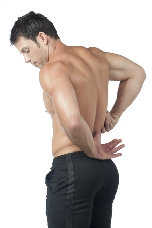 Image of man having a back pain against white background photo