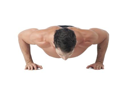 push: Image of a man having push up against white background