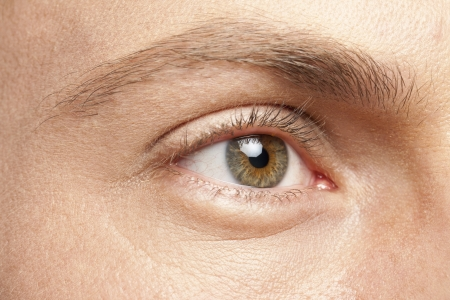 Close-up image of a man right eye looking away