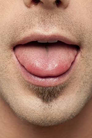 denote: Closed up cropped shot of a man showing his tongue Stock Photo