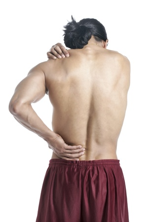 old man on a physical pressure: Back view of a man suffering from lower back pain standing on a white surface