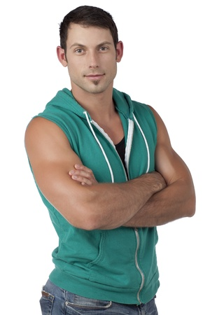 sleeveless hoodie: Man wearing green sleeveless hoodie with a crossed-arm portrait Stock Photo