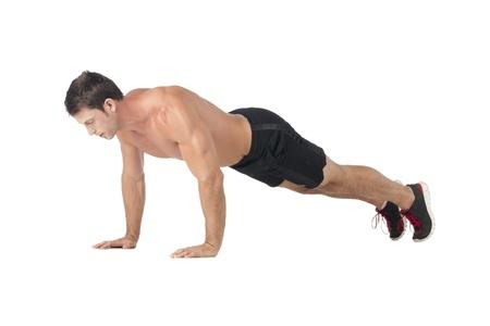 push: Image of masculine guy working push ups against white background