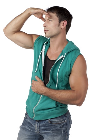 sleeveless hoodie: Side view image of muscular man looking for something on a white surface Stock Photo