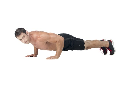 push: Image of a muscular man on push up over the white surface Stock Photo