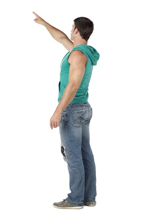 hooded vest: Back view image of muscular man pointing to the side of a white background Stock Photo
